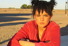 Film still of actress Karen Kennedy sitting outside