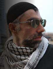 Filmmaker Usama Alshaibi wearing Iraqi fashion