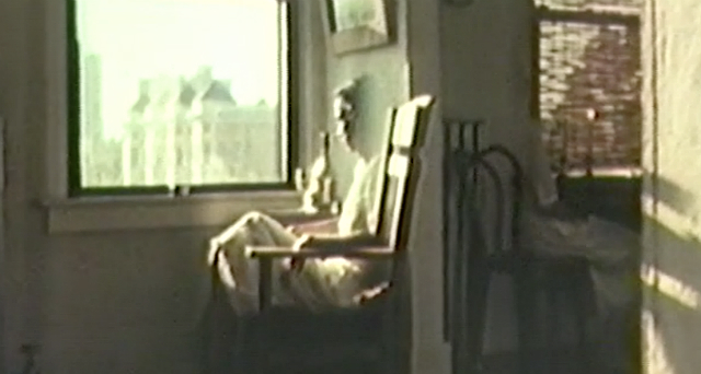 Woman sitting in a chair looking out the window