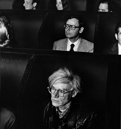 Andy Warhol watching a movie at the original Anthology Film Archives