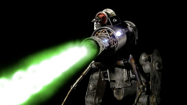 Giant robot shooting a green laser beam