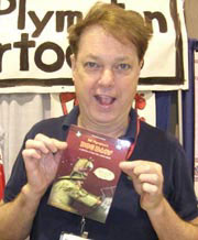 Bill Plympton holds up a copy of his Dog Days DVD