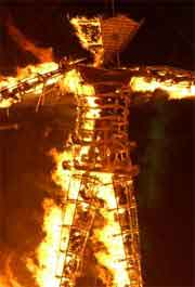 Burning Man sculpture on fire in the Nevada desert