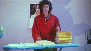 Woman standing at an ironing board with the Yellow Pages and National Geographic magazines