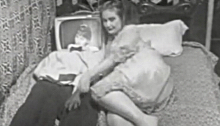 Woman lying next to a TV