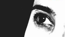 Black and white image of a woman's eye
