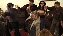 Iraqi family dancing in their home
