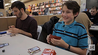 Teenage boy enjoys playing Magic the Gathering