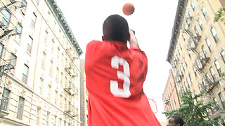 Street basketball player throws a big shot