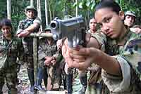 Female solider pointing a gun at the camera