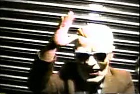 Man wearing a Max Headroom mask
