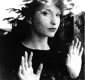 Maya Deren looking out a window in Meshes of the Afternoon