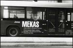 Bus with a photo of Jonas Mekas on the side