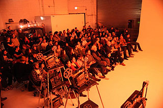Audience members watching an expanded cinema performance in Brooklyn