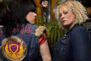 Two tough girls wearing jean jackets with a Montreal Underground Film Festival patch