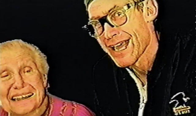 A man wearing glasses poses with his elderly mother