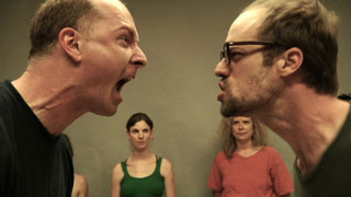 Two actors screaming at each other in an acting workshop