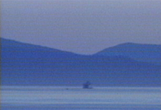 Blue landscape with boat, water and mountains