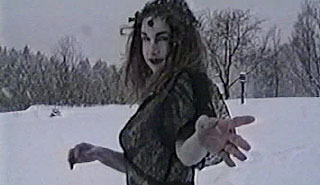 Ghostly image of a woman dances in a snowbank