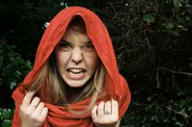 An angry Christina Wood wearing a red hood