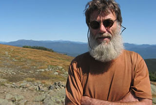 Portrait of filmmaker Skip Battaglia standing on a mountain
