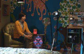 Carrie Brownstein talks directly to a video camera
