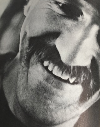 Extreme close-up of filmmaker Stan Vanderbeek