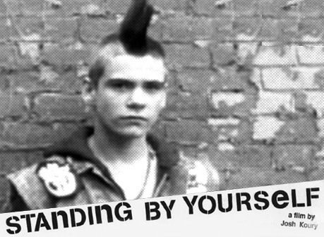 B&W photo of a teenage punk with a mohawk from Josh Koury's Standing By Yourself documentary