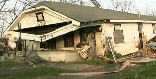 A collapsing house in the aftermath of Hurricane Katrina