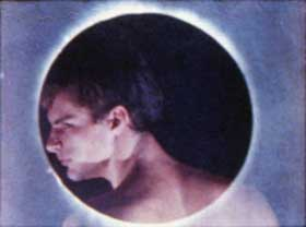 Film still of Twice a Man featuring a shirtless men framed by a glowing circle
