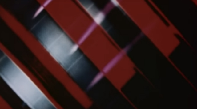 Abstract ribbons of red and silver from an experimental film by Jud Yalkut