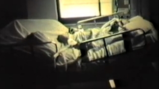 Dying man lying in a hospital bed