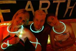 Three hipsters wearing glowsticks